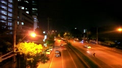 BANGKOK, THAILAND, 4 AUGUST 2014, Traffic on a road in the city centre. Night Stock Footage