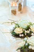 Festive table decoration in creamy white hues - stock photo