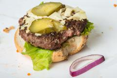 spoiled tasteless burger with roasted not Cutlets, - stock photo