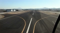 A plane heads down a runway and takes off. Stock Footage