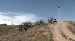 A vehicle sits on a path in a remote area. Stock Footage