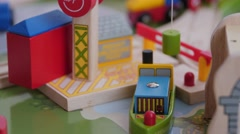 Playing with a toy boat and crane on a train table Stock Footage