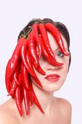 Pretty Woman with Red Hot Chili Peppers on Face Stock Photos