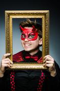 Funny devil with picture frame Stock Photos