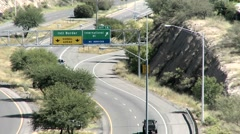 Vehicles travel along a highway close to the Mexican boarder. Stock Footage