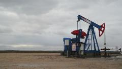 Timelapse pumpjack oil pump in the field Stock Footage