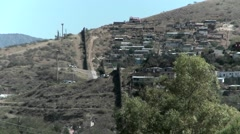 A landscape view of a hilltop community separated with a large wall. Stock Footage