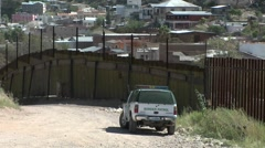 A border patrol vehicle is stationed at a border. Stock Footage