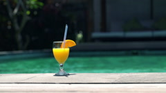 Summer drink with straw by the swimming pool HD Stock Footage