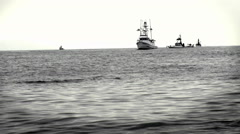 A group of boats sit together in the ocean. Stock Footage
