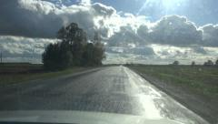 Wet asphalt road and car window after rain Stock Footage