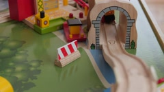 Playing with a toy train on a train table Stock Footage
