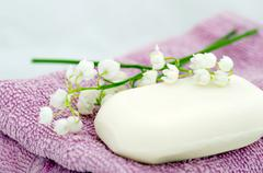 Spa setting of towels, soap and lilies of the valley Stock Photos