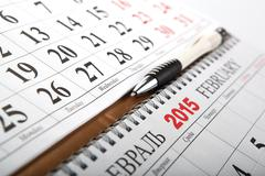 Wall calendars with pen laid on the table Stock Photos
