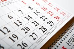 wall calendars laid on the table - stock photo