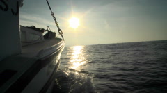 A boat sails in open waters towards the horizon. Stock Footage