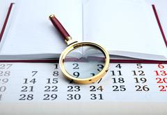 Magnifier on the diary Stock Photos