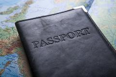 passport in the bag on a map - stock photo