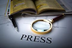 Magnifier and sign the press Stock Photos