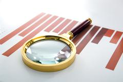 Magnifier lies on the printed diagram Stock Photos