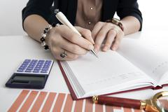 woman calculates future plans - stock photo