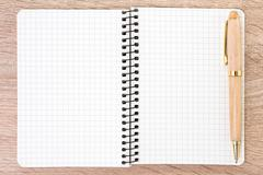 Stock Photo of White open notebook and pen