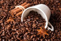 Inverted cup with coffee beans Stock Photos