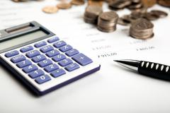 work on the calculator and papers - stock photo