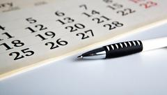 Stock Photo of calendar days with numbers and pen