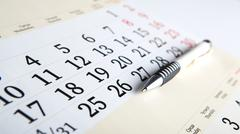 calendar days with numbers and pen - stock photo