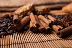 roasted coffee and cinnamon sticks - stock photo