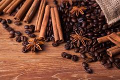 roasted coffee and cinnamon sticks - stock photo