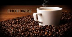 Cup of black coffee with roasted coffe beans with title coffee break Stock Photos