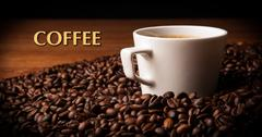 Cup of black coffee with roasted coffe beans with title coffee Stock Photos