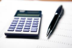 Work on the calculator and papers Stock Photos