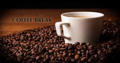 cup of black coffee with roasted coffe beans with title coffee break - stock photo