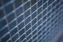 small metal grille from the fence - stock photo