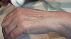 Senior Woman Moisturizing Her Hands with Cream. 4K Stock Footage