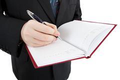 man is preparing for written work - stock photo