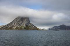 Huge mountain rock on Alkhornet, Svalbard, Arctic Stock Photos