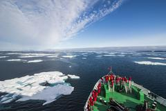 Expedition boat entering the pack ice in the Arctic shelf, Svalbard, Arctic - stock photo