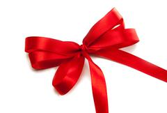 red ribbon with a bow - stock photo