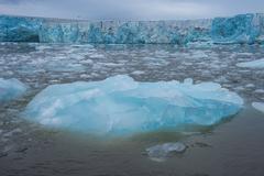 Shining blue glacier ice, Hornsund, Svalbard, Arctic, Norway Stock Photos