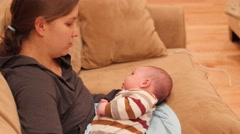 Young mother comforting her newborn baby Stock Footage