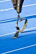 Handicapped sprinter walking Stock Photos