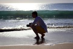 Photographer on a beach Stock Photos