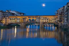 Ponte Vecchio bridge over the River Arno and full moon, Florence, UNESCO World Stock Photos