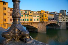 Ponte Vecchio over the River Arno at sunset, Florence, UNESCO World Heritage Stock Photos