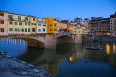 Stock Photo of Ponte Vecchio over River Arno at dusk, Florence, UNESCO World Heritage Site,
