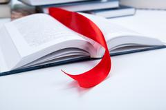 open book with red bookmark - stock photo